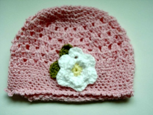 Candyfloss pink cotton toddler beanie with daisy detail