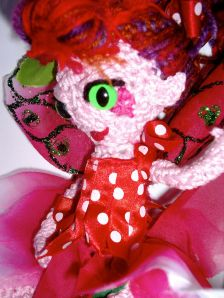 Red and pink crochet fairy doll