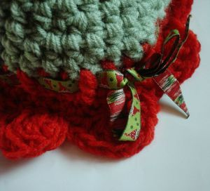 Detail of crochet flower hat for baby girls showing ribbon