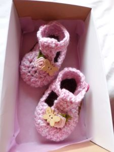Pink booties in a box