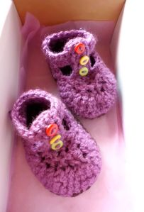 purple baby booties with buttons