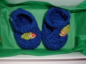 Blue snail infant crochet booties in the box