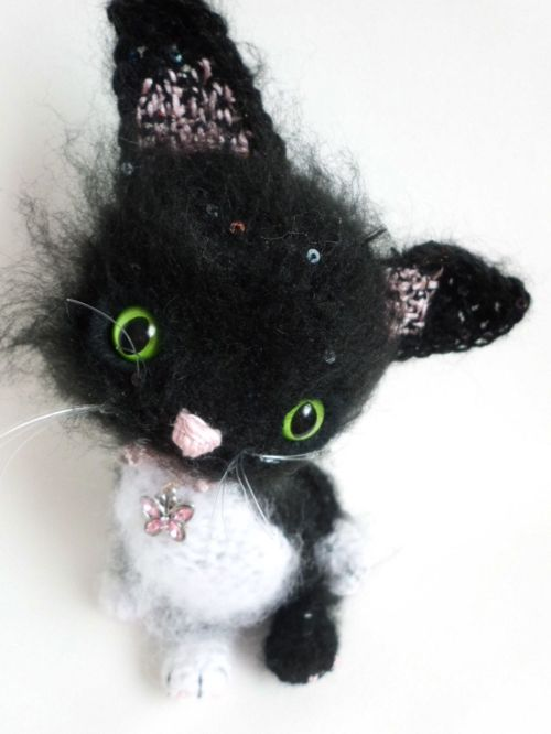 Black and white cute crochet kitten